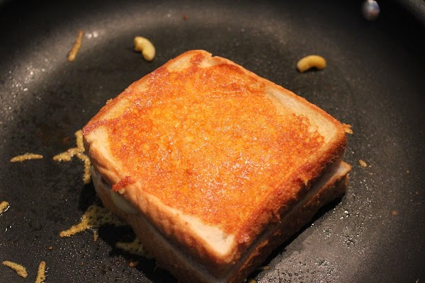 Toast on med heat the first side of the sandwich until golden. Don't burn...