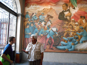 Photo: Benito Juarez, with Mexican flag, defeated the hated French invaders. Juarez looks over the shoulders of Moran and our guide.