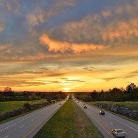 Highway Sunset. by Jim Dawson - Transportation Roads ( limestone, interstate, sunset, automobile, louisville_lexington_kentucky, i-64,  )