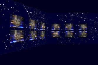 """Photo: Fotoprojekt Motion Polarity © Franz Immoos Amsterdam 2014 Bei den Arbeiten werden Abbildungen von Masken mit einem bewegten Hintergrund als """"Fotocollagen"""" miteinander kombiniert. Das Projekt besteht aus diesen Maskenbilder diein einer Mann-Frau Gegenüberstellunginstalliert werden. Im abgedunkelten Raum werden Sternenbilder projiziert. (bzw mit fluorezierender Farbe aufgemalt."""