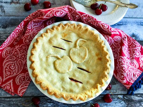 Baked Cherry Pie With A Red Napkin.