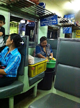 "Photo: 3rd class train from Bangkok to Aranyaprathet.  Apparently, on a ""dining car"" where lady is peeling green papayas."