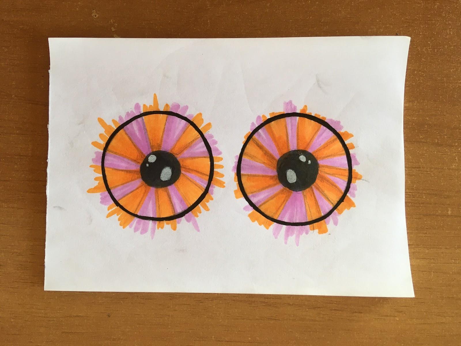 Ojos pintados y remarcados con fibras.