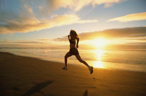 Women Running on Beach with Sunset