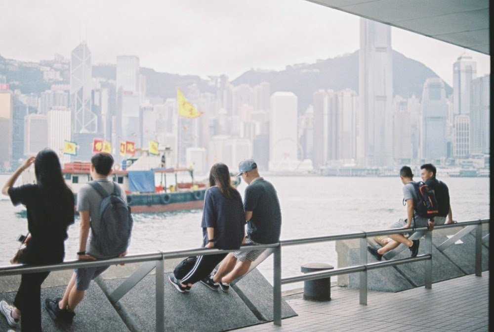 People sitting at star ferry. Jun 2018.