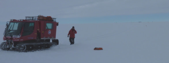 Photo: Note the dark on the right on the horizon - South Pole Station