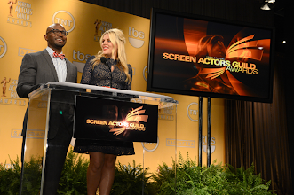 Photo: Taye Diggs & Busy Philipps at the podium to announce the 19th SAG Awards nominees  Credit: Michael Buckner