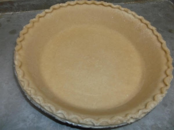Place pie shell on a rimmed baking sheet; set aside.