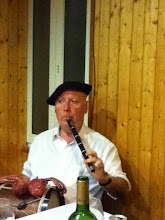Photo: Our last dinner was more about the culture than the food as we dined at a men's gastronomical club in Bilboa.   This flute player in the acknowledged master of the Basque 3 hole flute, even though he is missing  1 1/2 fingers on his left hand.  Right hand plays the drum.