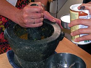 Photo: pounding herbs for satay marinade