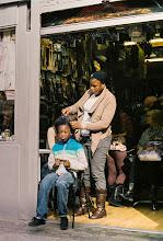 Photo: Woman combs young man's hair #streetphotography #dublin