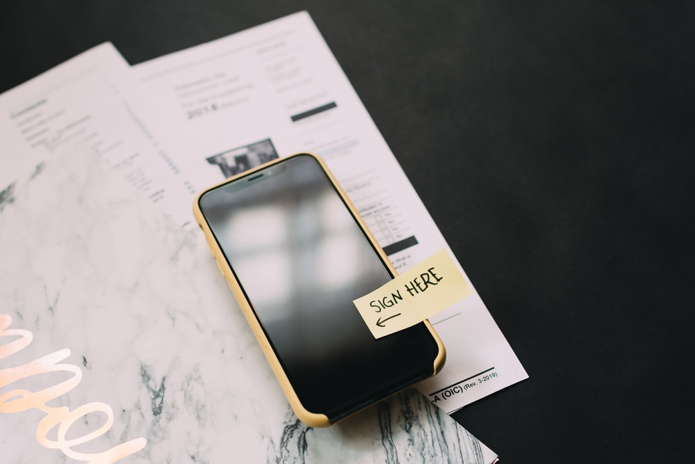 A cell phone representing digital, smart contracts with Ethereum.