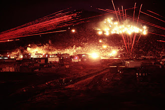 Photo: Time exposure of M60 7.62 cal. machine gun(S), M2 .50 cal. Browning Machine Gun, and twin 40 mm anti-aircraft Bofor (Pom-Pom) guns mounted on a M42 Duster (tank) firing long bursts of tracers at night. Copyright James Speed Hensinger.