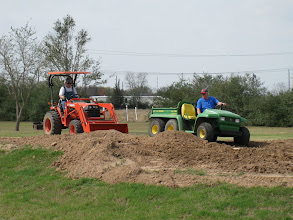 Photo: Ed Rains scrapping up dirt while Peter Bryan waits