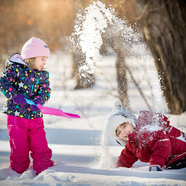 Snow Shower by Mike DeMicco - Babies & Children Child Portraits ( purple, little, kids, fun, cute, portrait, playing, throw, laughing, sweet, winter, happy, snow, outdoor, shower )