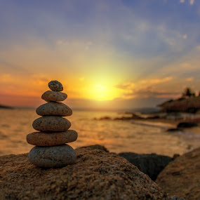 stone balance in sunrise by Grigor  Ivanov - Landscapes Sunsets & Sunrises ( calm, pebble, concept, relax, stability, stone, rock, yellow, beauty, heap, balance, tranquil, nature, pile, light, spa, orange, isolated, symbol, white, sea, relaxation, blue, background, peace, zen, meditation, sunrise, stack, waterfront )