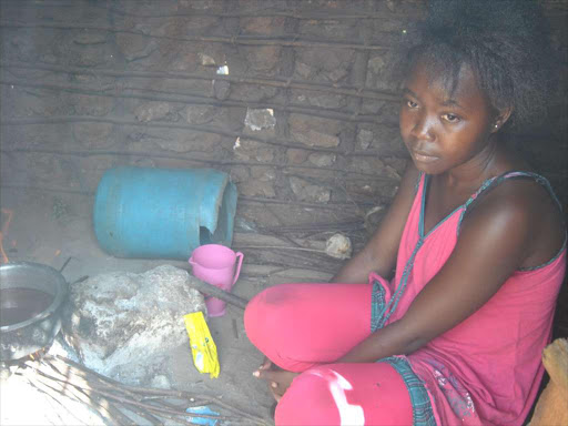 Jessica Mbela prepares tea for her family in Jimba in Kilifi county. Her mother died of torture in the Middle East. /ALPHONCE GARI