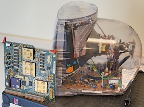 Photo: A TV and a circuit board. Why is the TV enclosed in clear glass?