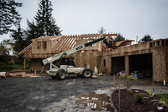 Photo: Set the dormer rafters on the left, then cut the 27' rafters and set them, then took lunch.