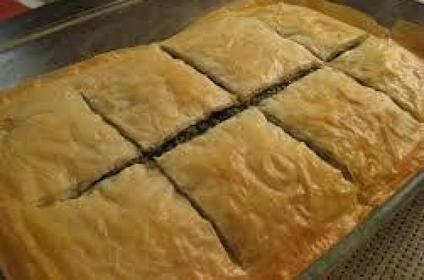 For the final layer, cover the lamb with three more layers of phyllo dough,...