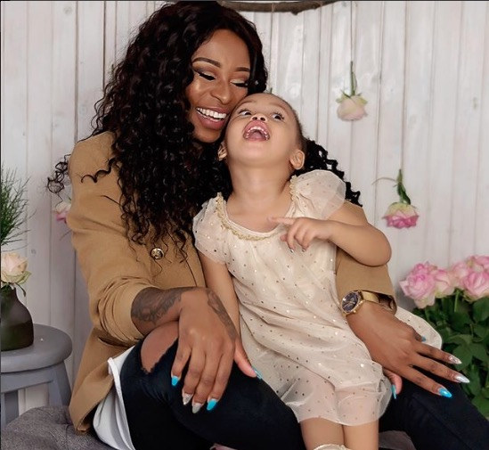 Zinhle with her and AKA's baby girl, Kairo.