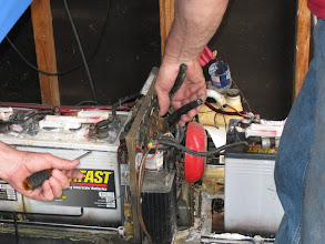 Photo: Peter Bryan with tools in hand working on electricity and living to tell about it.