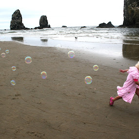 Bubble Girl by Tom Carson - Babies & Children Children Candids ( sand, seashore, rocky, waves, blond, bubbles, sea, beach, seascape, robe, running, child, girl, seagull, tide, wave, pink, toddler )