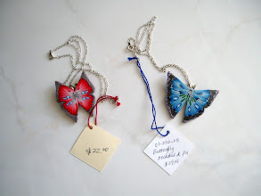 "Photo: Butterfly. Polymer Clay Pin or necklace (the chain is 18""). Red: $22. Blue: $29.00 If you wish to have a sterling silver chain please add $10.00."