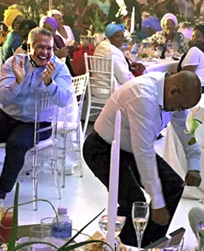 Gavin Watson applauds as Jacob Zuma dances at Zuma's 73rd birthday party.