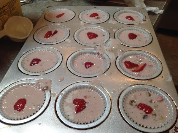Fill each muffin tin about 3/4 full, and top with additional slices of strawberries...