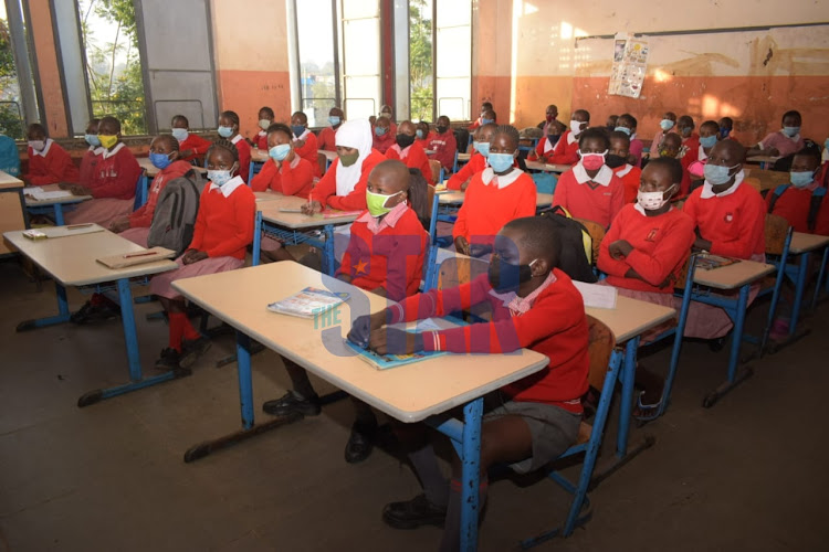 67 grade 6 pupils of Mukuru Primary school settle in class on their first day of school on January 4, 2020. The class has a capacity of 94 students with more still to report on day one. January 4, 2021.
