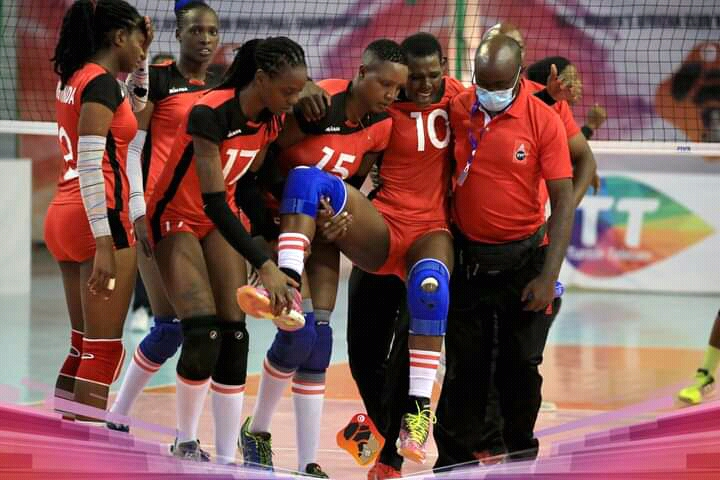 Kenya Pipeline's Trizah Atuka is helped off the court after sustaining an injury against Customs of Nigeria at the ongoing Africa Club Championships