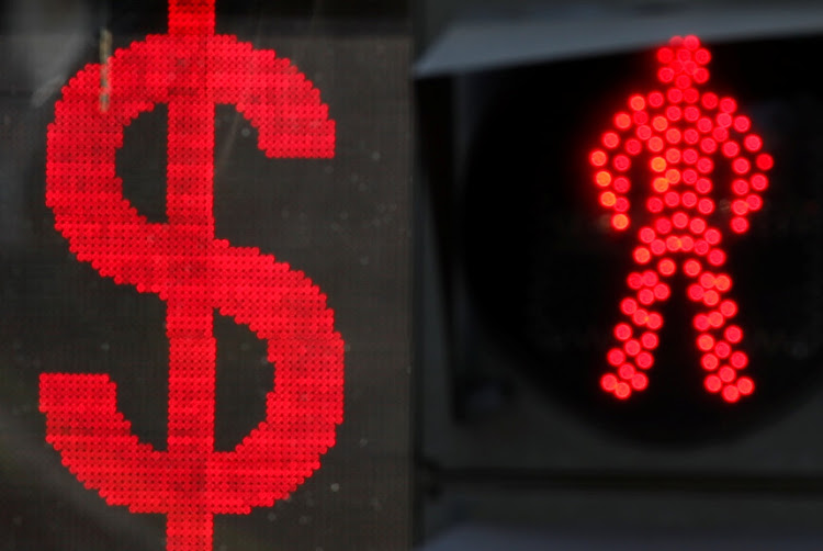 The US dollar sign is seen on an electronic board next to a traffic light in Moscow on August 10 2018. Fresh US sanctions against Russia will take effect on Monday relating to its use of a nerve agent against a former Russian agent and his daughter in Britain.