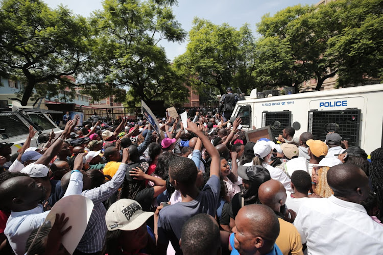 Supporters of self-proclaimed prophet Shepherd Bushiri outside court on February 6 2019. Bushiri and his wife Mary, who have been accused of money laundering and fraud, were granted bail of R100,000 each.