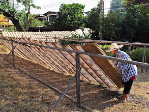 Photo: propping the racks on a frame to dry the rice paper wrappers in the sun
