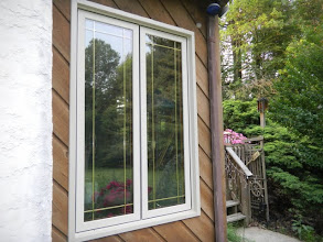 Photo: Exterior view of twin casement window with prairie grids