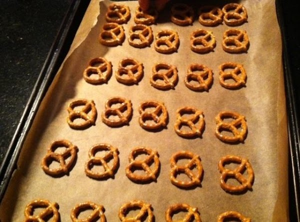 PREHEAT OVEN TO 350  LAY PRETZELS ON PARCHMENT LINED BAKING SHEET.