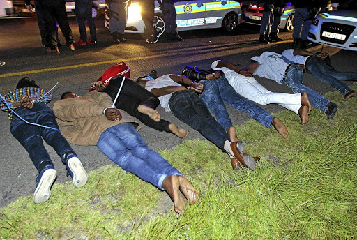 LOOKING FOR LAWYERS  Eight Marikana massacre suspects were arrested on the N1 freeway near the  Huguenot Tunnel and left trussed next to the road for three hours while the police waited for minister Fikile Mbalula to arrive to share in the 'big breakthrough' glory