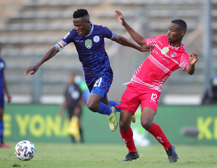 Khomotso Marebane of Pretoria Callies challenged by Thamsanqa Sangweni of Chippa United during the Nedbank Cup semi final match between Pretoria Callies and Chippa United at Lucas Masterpieces Moripe Stadium on April 17, 2021 in Pretoria.