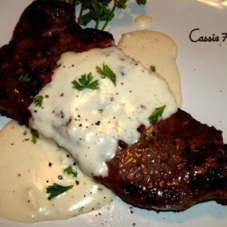 Steak With Creamy Garlic Parmesan Sauce.