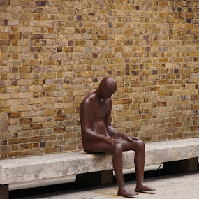 City dweller by Pavel Laberko - Buildings & Architecture Architectural Detail ( bench, pwcdetails, bricks, wall, man )