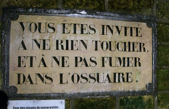 Photo: Sign in the catacombs...probably says something about respecting the dead.