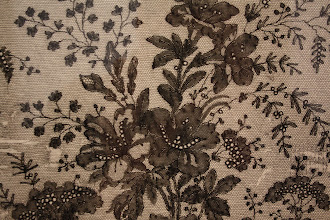 "Photo: A detail of extremely fine lace from the ""Concealed and Revealed"" display"