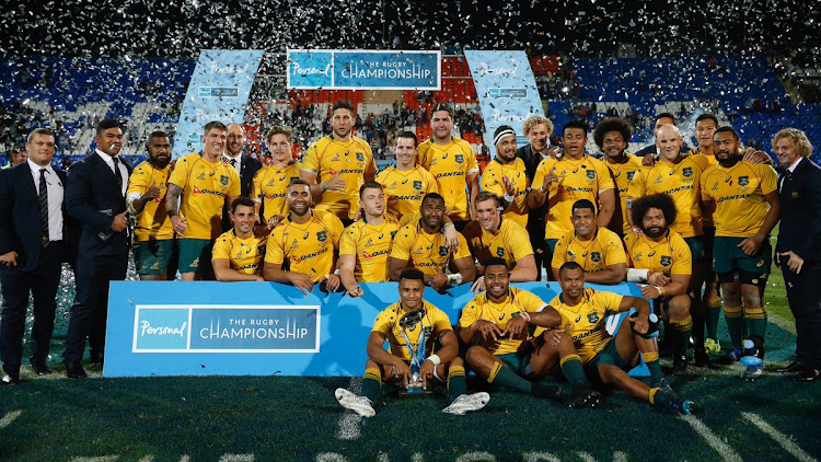 Australia celebrate after winning their match against Argentina to finish second on the Rugby Championship table.