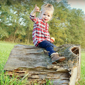 mischievous by Toby Turley - Babies & Children Child Portraits ( toddlers, fall, nature, smiles, logs )
