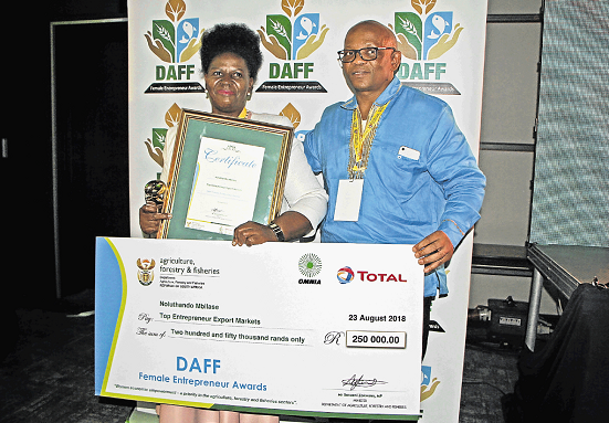 REAPING AWARDS: Eastern Cape department of agrarian reform MEC Xolile Nqatha congratulates Fort Beaufort farmer Noluthando Mbilase.