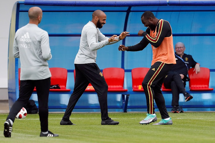 Belgium assistant coach Thierry Henry and Romelu Lukaku during training.