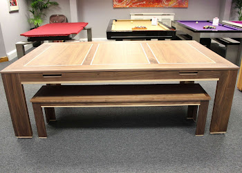Wood bench under a wooden rollover pool table