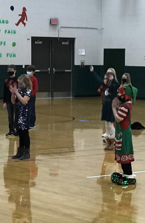 1st grade students practicing for Christmas Concert