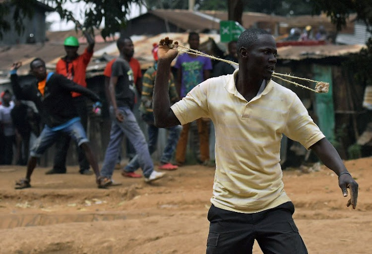 Protesters clash with Kenyan police forces in Kibera slum in Nairobi on August 12, 2017, following the announcement of the election victory of President Uhuru Kenyatta. Three people, including a child, have been shot dead.